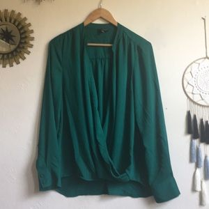 The limited emerald green surplus top. Size L.